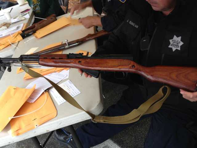 A photo provided by the Oakland POlice Department shows weapons taken off the streets in a buy-back program in Oakland and San Francisco, on Saturday.