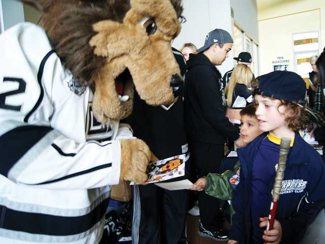 Los Angeles Kings mascot, Bailey, spends some one-on-one time with 8-year-old local Kings fan, Jacob Melanson, whose favorite player is Kings center Anze Kopitar. Melanson was one of several local fans who showed up at Ice Station Valencia Sunday for a special Kings appearance.