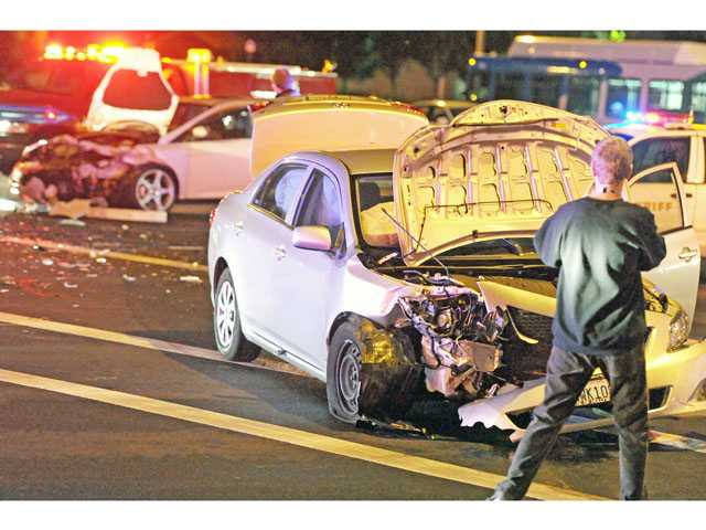 Sheriff's deputies and firefighters responded to the scene of a two-car collision at McBean Parkway and Valencia Boulevard in Valencia on Monday night. (Jonathan Pobre/The Signal)