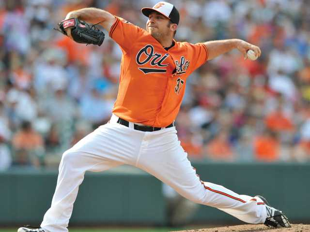 Baltimore Orioles starting pitcher Dana Eveland delivers against the Cleveland Indians during the third inning on June 30 in Baltimore.