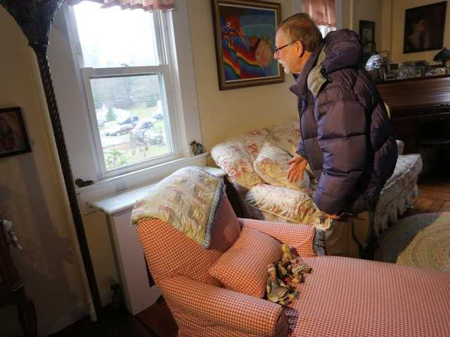 Gene Rosen looks out a window in his home where he took in four girls and two boys on the day of the shooting.