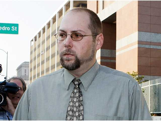 In this Nov. 1, 2011 file photo, Christopher Chaney, 35, of Jacksonville, Fla., leaves federal court in Los Angeles. Chaney has agreed to plead guilty to hacking into the email accounts of celebrities such as Christina Aguilera, Mila Kunis and Scarlett Johansson, whose nude photos eventually landed on the Internet, according to court documents filed Thursday, March 22, 2012.