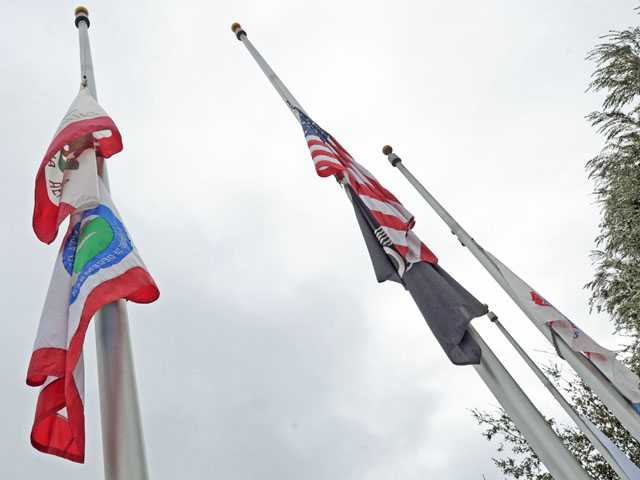 Flags fly at half-staff at Veterans Historical Plaza on Monday.