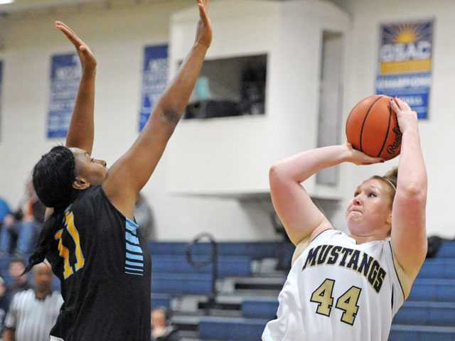 The Master's College's Theresa Brown (44) shoots over Great Falls defender Kindra Jones during Monday night's game at The Master's College.