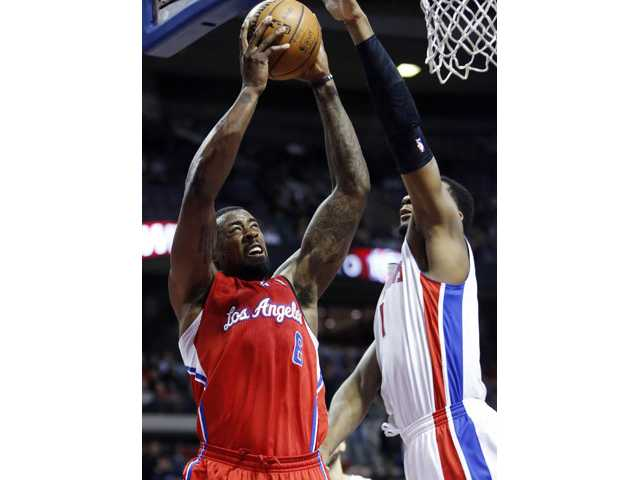 Los Angeles Clippers center DeAndre Jordan (6) goes to the basket against Detroit Pistons forward Andre Drummond (1) in Auburn Hills, Mich., on Monday.