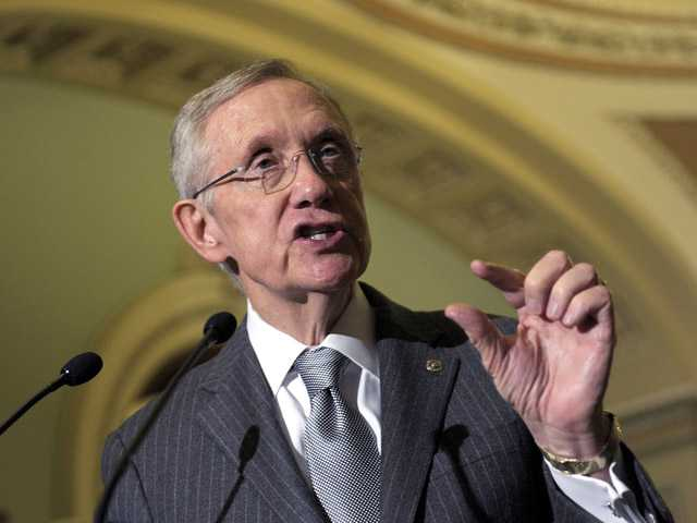 Senate Majority Leader Harry Reid of Nevada speaks to reporters following the Democratic policy luncheon on Capitol Hill in Washington, Tuesday