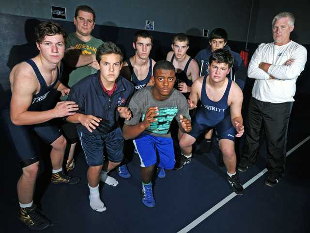 Trinity Classical Academy's wrestling team, back row from left, Head coach Chris Leigh, Dakota Prochnow, Erik Ohl and Michael Nasrallah. Front row from left, Kasey Klar, Joey Ceglia, Jordan Thomas, John Nichols and Dave Prochnow. It's the area's first wrestling team in nearly 35 years.