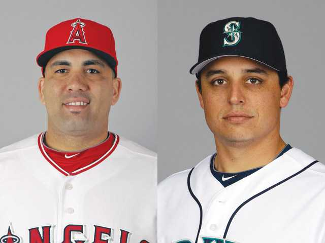 The Los Angeles Angels traded Kendrys Morales, left, for Seattle Mariners pitcher Jason Vargas on Wednesday.