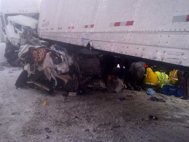 This photo provided by the Iowa State Patrol shows the scene of a 25-vehicle pileup that killed three people Thursday.