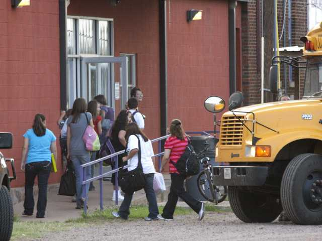 Students arrive for the first day of classes at the Harrold Independent School District in Harrold, Texas.