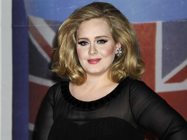 In this Feb. 21 photo, performer Adele arrives for the Brit Awards 2012 at the O2 Arena in London.