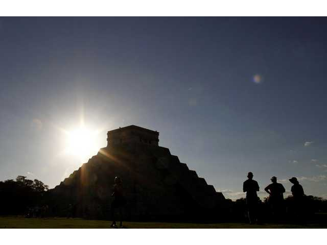 People gather in front of the Kukulkan Pyramid in Chichen Itza, Mexico.