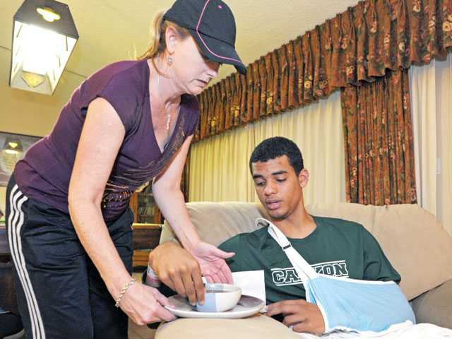 Melinda Davis-Gillinger makes vegetable soup for son Dean Hendrix-Davis in their Newhall home on Wednesday.