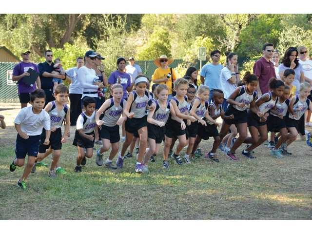 Members of the Santa Clarita Storm youth cross country team, ages 6 to 8,  run at O'Melveny Park in Los Angeles.