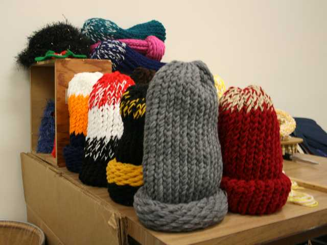 This Dec. 7, 2012 photo shows some of the hats that inmates at the South Dakota State Penitentiary in Sioux Falls, S.D., have knitted.