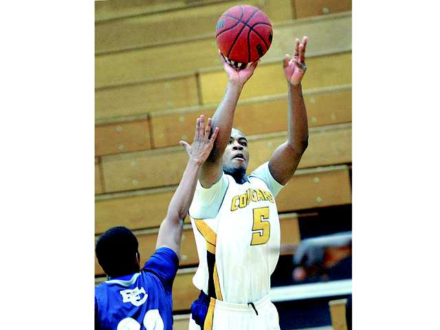David Horst (11) drives to the basket against El Camino defender Joshua Wilson at College of the Canyons on Thursday.
