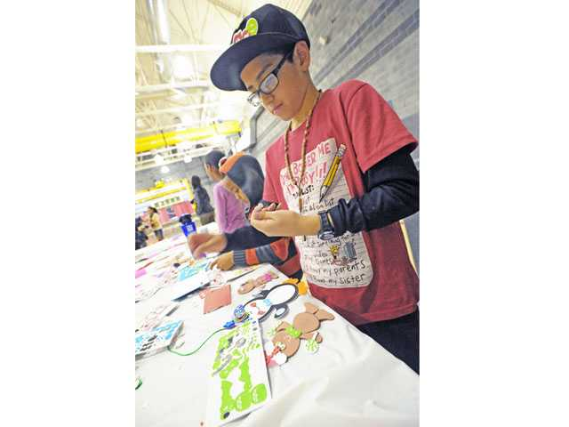 Josh Huerta, 9, works on crafts at the Santa Clarita Community Center in Newhall on Thursday.