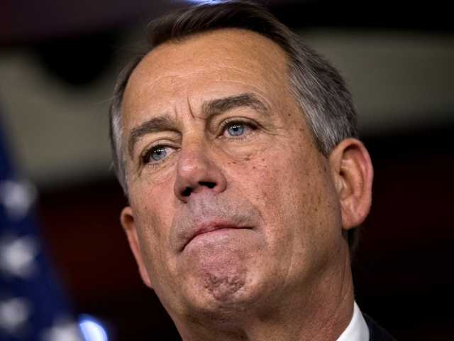 Speaker of the House John Boehner speaks to reporters about the fiscal cliff negotiations at the Capitol in Washington, Friday, Dec. 21.