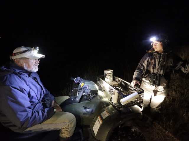 Julie Sullivan, right, talks with Jim Harrison, left, before heading out in the middle of the night during an annual 24-hour Christmastime ritual to count birds along the Texas Gulf Coast in Mad Island, Texas, on Monday.