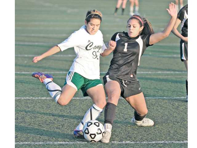 Canyon's Vanessa Quintero (92) takes a shot on goal in the first half against Stockdale High defender Sabrina Miller. The teams tied 2-2.