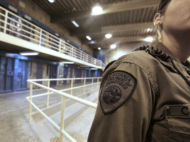 In this Aug. 17, 2011 file photo, a correctional officer works at one of the housing units at Pelican Bay State Prison near Crescent City.