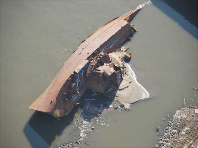 The United States Coast Guard photo shows a WWII minesweeper on the Mississippi River near St. Louis, Mo., on Nov. 28.