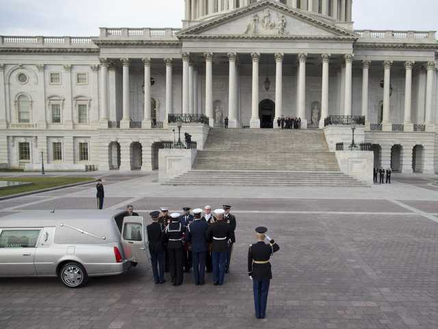 The casket of Sen. Daniel Inouye, D- Hawaii, is carried into the Capitol to lie in state in the Capitol Rotunda on Thursday, in Washington.