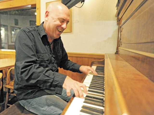 "Author of ""Dating and the 50-Year-Old Man"" and musician Stephen Hemmert enjoys a moment on the piano at Le Chene  French Cuisine Restaurant on Sierra Highway in Agua Dulce."