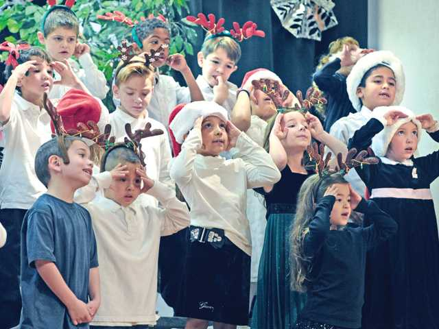 "First-graders sing ""Rudolph the Red-Nosed Reindeer"" at Sulphur Springs Community School during the Holiday Hats program in Canyon Country on Wednesday."