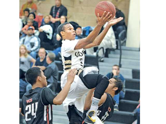The Grizzlies' James Chevious (3) goes up against Village Christian on Saturday at Golden Valley.
