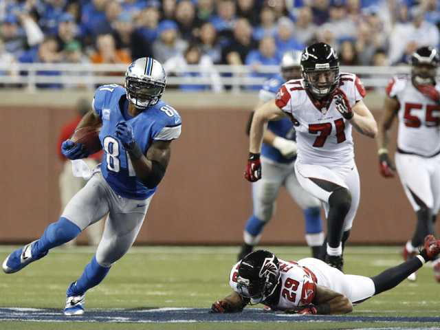 Detroit Lions wide receiver Calvin Johnson (81) breaks away from Atlanta Falcons defensive back Dominique Franks (29) during the third quarter at Ford Field in Detroit on Saturday.