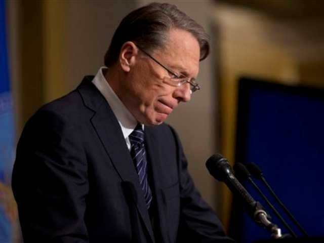 National Rifle Association executive vice president Wayne LaPierre pauses as he makes a statement during a news conference in response to the Connecticut school shooting, on Friday, Dec. 21, 2012 in Washington.