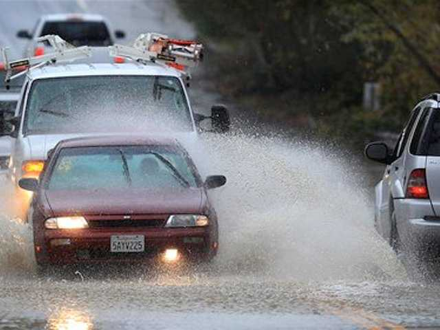 Cars are awash in floodwaters on Windsor Road at Pool Creek in Windsor, Calif., Friday Dec. 21, 2012 during a winter storm.