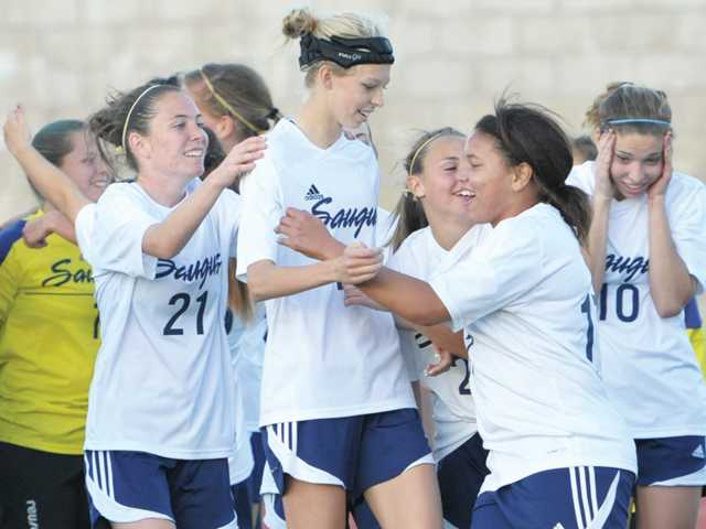 Saugus girls soccer celebrates its victory over Tesoro.