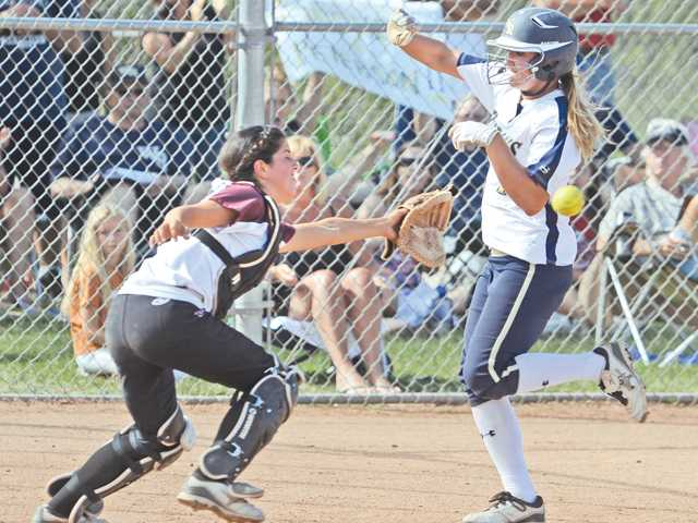 West Ranch softball's Julia Lombardi scores a run.