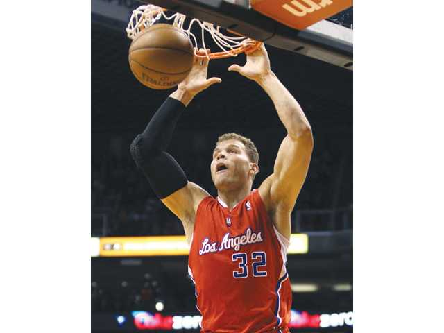 Los Angeles Clipper Blake Griffin slams down a basket against the Phoenix Suns on Sunday in Phoenix.