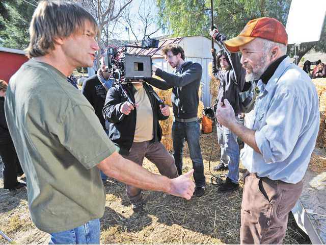 "Actors Charlie O'Connell as ""Huff,"" left, and Clint Howard as ""Karl,"" right, rehearse a scene for the camera crew during the filming of the feature film ""Huff"" in Santa Clarita on Dec. 14."