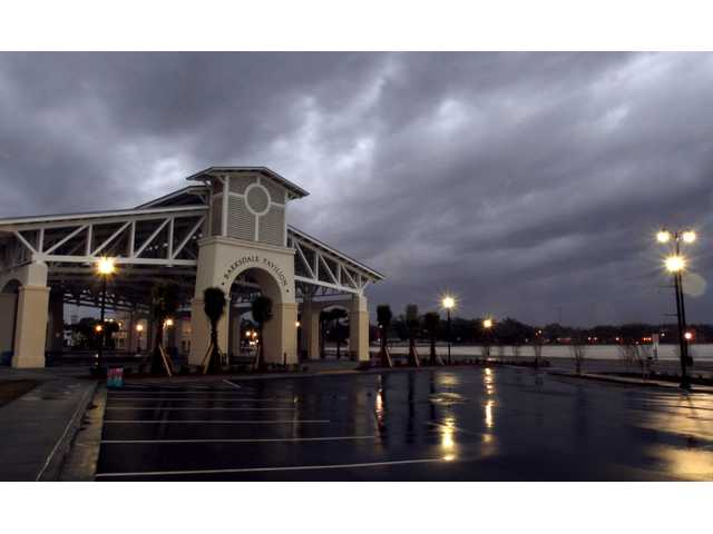 Storm clouds roll past Barksdale Pavilion at Jones Park in Gulfport, Miss.