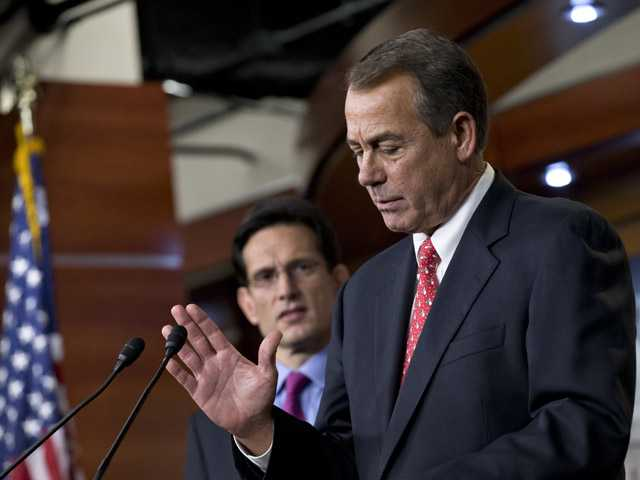 Speaker of the House John Boehner, R-Ohio, joined by House Majority Leader Eric Cantor, R-Va., left, speaks to reporters about the fiscal cliff.