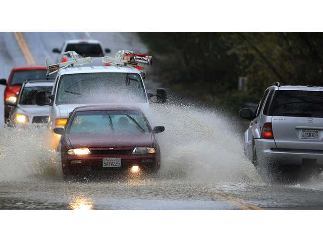 Cars are awash in floodwaters on Windsor Road at Pool Creek in Windsor on Friday.