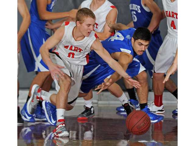 Hart's Frank Lonsinger, left, goes for a loose ball against Burbank on Wednesday at Hart High School.