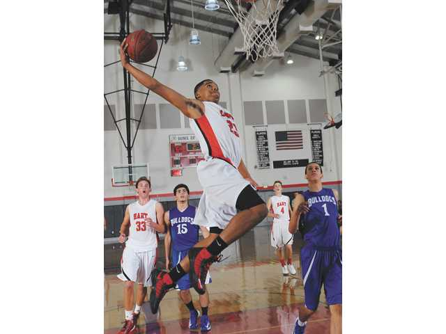 Hart's Lewis Stallworth (23) goes for a shot during a game against Burbank on Wednesday at Hart High School.