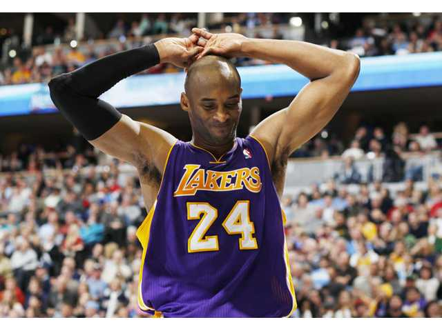 Los Angeles Lakers guard Kobe Bryant reacts during a game against the Denver Nuggets on Wednesday in Denver.