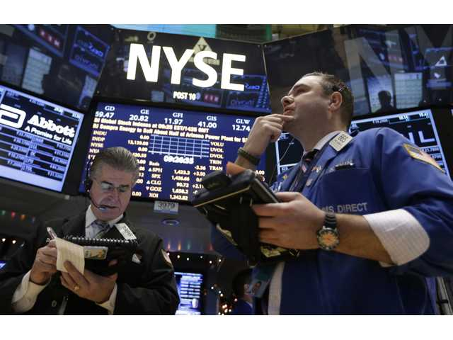Daniel Kryger, left, and Kevin Lodewick Jr., right, work on the floor of the New York Stock Exchange in New York.