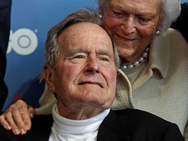A spokesman for former President George H.W. Bush says the 88-year-old is alert and talking to medical staff after being admitted to the intensive care unit at a Houston hospital.