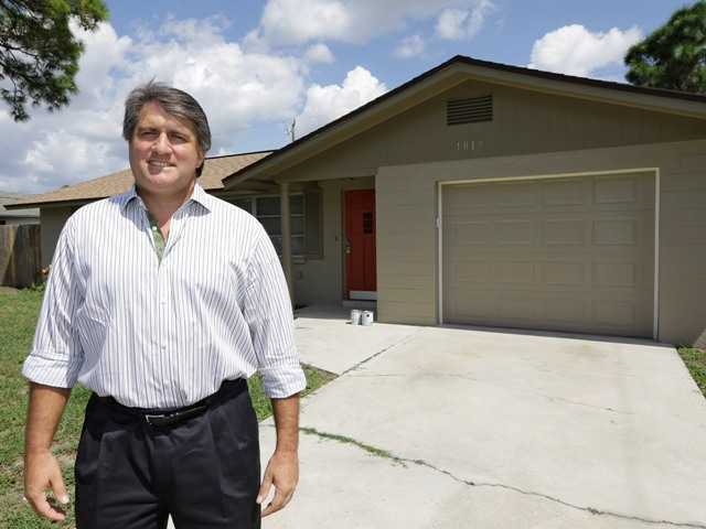 In this Sept. 12, 2012, photo, Andrew Neitlich poses in front of one his investment homes in Venice, Fla. Neitlich once worked as a financial analyst picking stocks for a mutual fund. During the dot-com crash 12 years ago, Neitlich didn't sell his stocks, but like many others he is selling now. An analysis by The Associated Press finds that individual investors have pulled at least $380 billion from U.S. stock funds since they started selling in April 2007.