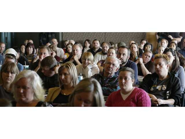 Teachers listen during concealed weapons training for 200 Utah teachers Thursday.