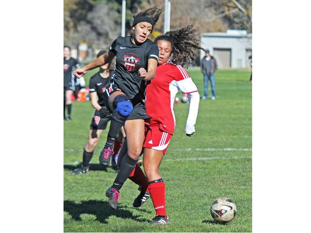 Hart's Natalie Gilmore advances the ball past Paraclete's Lauren Parish on Thursday at Hart High. The Indians beat Paraclete 3-0 to go 2-0 on the first day of their own Hart Soccer Showcase.