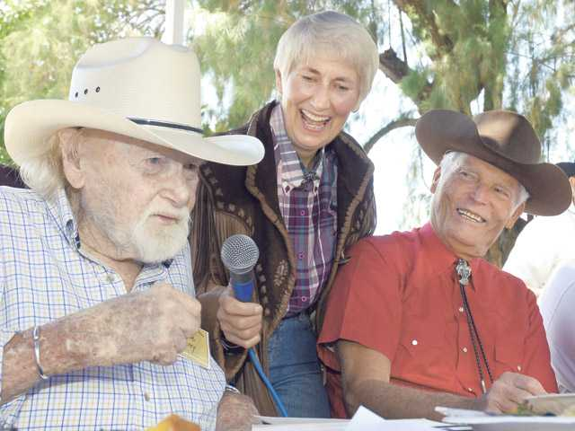 Harry Carey Jr., left, relates a childhood memory of his father and silent screen star William S. Hart to Santa Clarita City Councilwoman Laurene Weste, center, and actor Ty Hardin at Tesoro Adobe Park on May 31, 2009.