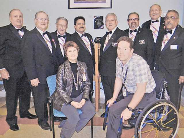 Front: Chief Marianne Davis, Specialist Larry Foster. Top: Tom Jezik, Ed Hoover, Dick Desjardins, Mark Maynez, Angel Chacon, Phil Horlings, John Springer and Ray Broderick at dedication for the Cybercafe Computers.